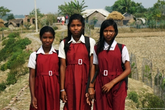 Village girls on their way home from school.