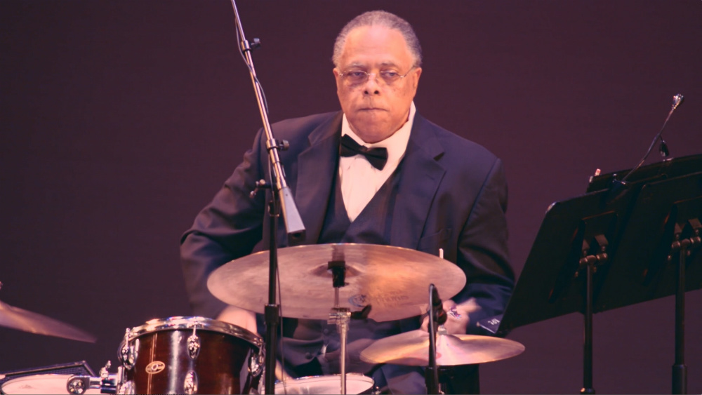 Co-artistic director and drummer Clarence Acox